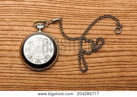 pocket watch on the table, old watch, mechanical watch