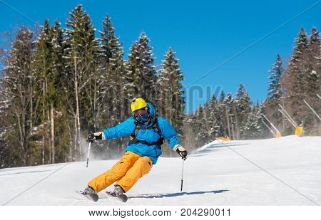 Professional Skier Riding Down At The Winter Resort In The Carpathians Mountains Copyspace Extreme T