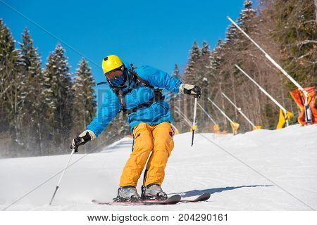 Full Length Shot Of A Skier Riding On The Slope At The Winter Resort In The Carpathians Mountains Ex