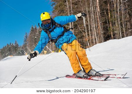Low Angle Shot Of A Professional Skier Skiing On The Slope Recreation Active Sport Seasonal Resort S