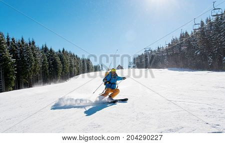 Professional Skier Riding Down The Hill Enjoying Skiing In The Mountains Outdoors Sport Recreation E