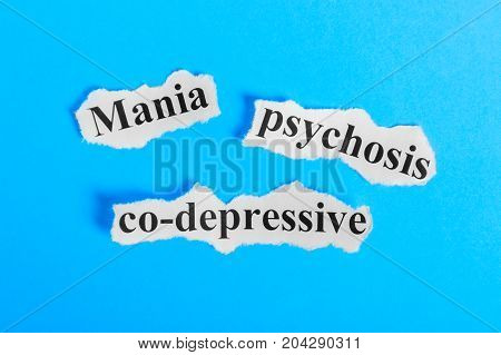 Mania co-depressive psychosis text on paper. Word Mania co-depressive psychosis on a piece of paper. Concept Image. Mania co-depressive psychosis Syndrome