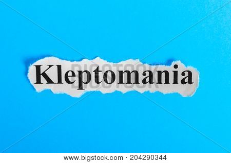 Kleptomania text on paper. Word Kleptomania on a piece of paper. Concept Image. Kleptomania Syndrome