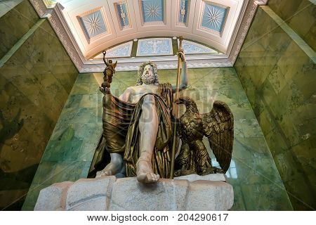 ST PETERSBURG, RUSSIA - JUNE 10, 2015: Statue of Jupiter in Jupiter Hall of Hermitage museum. This is one of the biggest antique sculptures remained up to present time