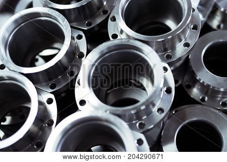 Close-up of a set of metallic gears and parts produced in metal factory