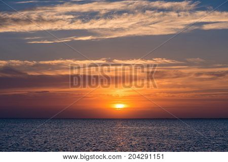 sunset at sea. dawn at sea. sunset over the water. the dawn of the sun above the water