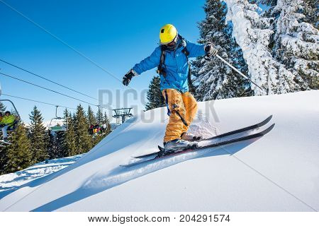 Professional Freeride Skier Skiing In The Mountains On A Sunny Winter Day Nature Recreation Active S