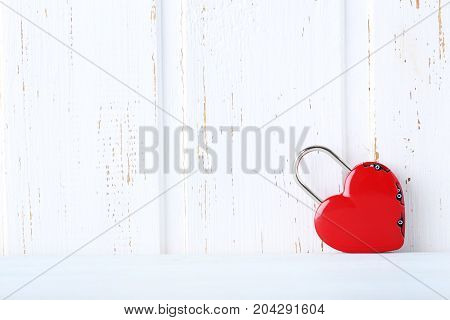Heart Shaped Padlock On White Wall Paneling Background