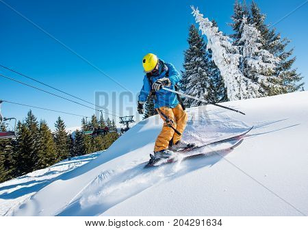 Shot Of A Professional Freeride Skier Riding Down In The Carpathians Mountains At Winter Resort On A