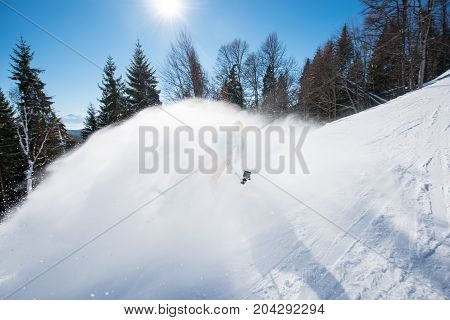 Action Shot Of Skier Taking Selfies With A Camera On Selfie Stick While Skiing On Fresh Powder Snow