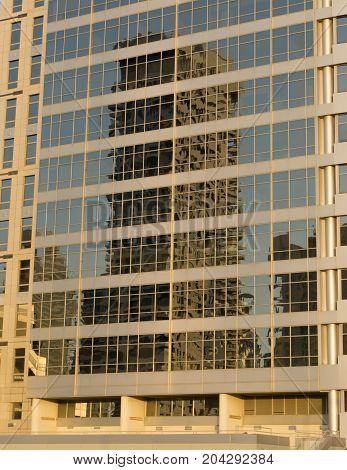 Close-up of the glass office building with reflections and sunflare effect.