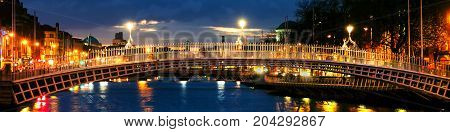 Dublin Ireland. Night view of famous Ha Penny bridge in Dublin Ireland