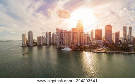 Aerial view of downtown Miami at sunset. All logos and advertising removed.