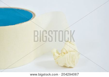 adhesive tape roll and scrap on white background