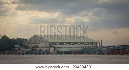 Warehouse Under Sky At Sunset