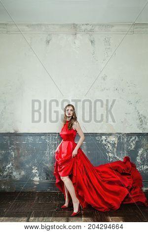 Sensual Woman Fashion Model Wearing Stylish Red Dress on Retro Background