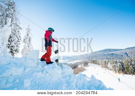 Full Length Shot Of A Snowboarder Standing On Top Of A Slope Looking Around Enjoying The View Copysp