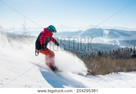 Shot Of A Man Snowboarder Riding On The Snowy Slope At Winter Ski Resort In The Mountains, Wearing S