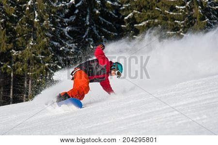 Male Snowboarder Riding On The Snowy Slope On Beautiful Sunny Day. Freeride Snowboarding Copyspace E