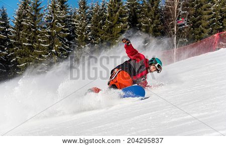 Male Snowboarder Enjoying Skiing In The Mountains On A Sunny Winter Day. Ski Season And Winter Sport