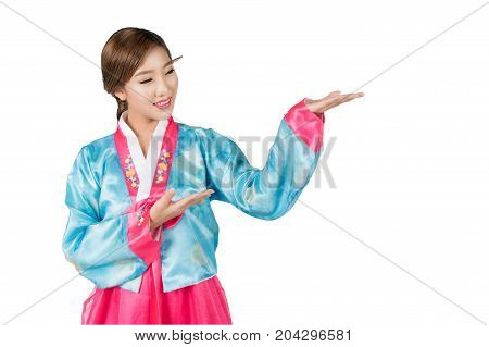 Korean Woman with Hanbok the traditional Korean dress gesturing open hand with copy space for product or text in white background with clipping path.