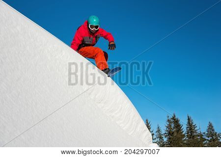Shot Of A Snowboarder Riding On Dangerous Slope On Sunny Winther Day In The Mountains Copyspace Extr