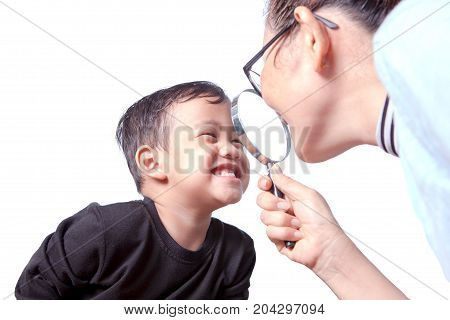asian children toothy smiling face with happiness emotion and female dentist close up magnifier lens to teeth