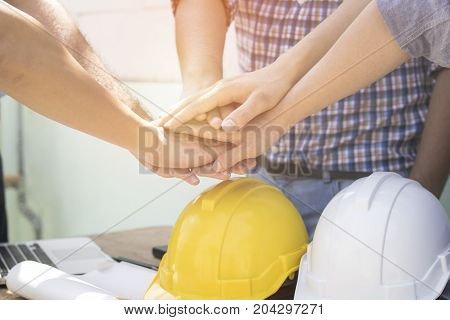 engineer and businessman take hand coordination at Construction site