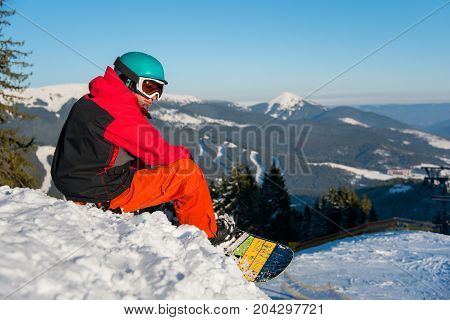 Shot Of A Snowboarder Enjoying Beautiful View Of Snowy Mountains, Winter Ski Resort, Relaxing On The