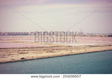 The junction of the Suez Canal into the Mediterranean at Port Said and Port Fouad with their saltworks