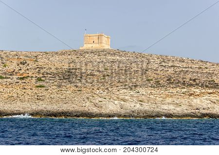 Look on St. Mary's Tower from the sea. Malta Gozo Comino.