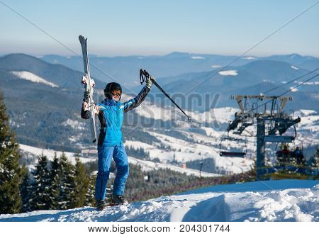 Full Length Shot Of A Happy Woman Posing With Her Skis On Top Of The Mountains Celebrating Success H