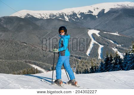 Full Length Shot Of A Happy Woman Skiing In The Mountains At Ski Resort Copyspace Happiness Enjoymen