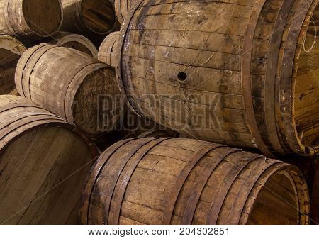 closeup of some wooden wine barrels in stock
