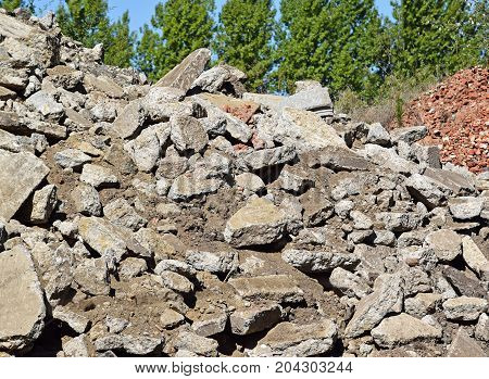 Broken concrete and brick construction materials at the construction site