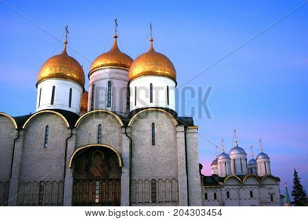 Dormition and Twelve apostles churches of Moscow Kremlin. UNESCO World Heritage Site. Color photo. Blue sky background.