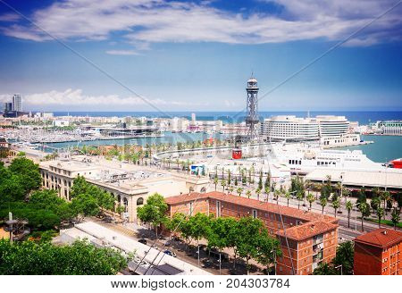 Cityscape of Barcelona with port Vell, , toned