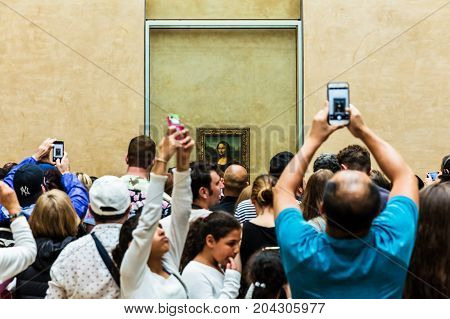 Paris France - July 01 2017: Visitors take photo of Leonardo DaVinci's