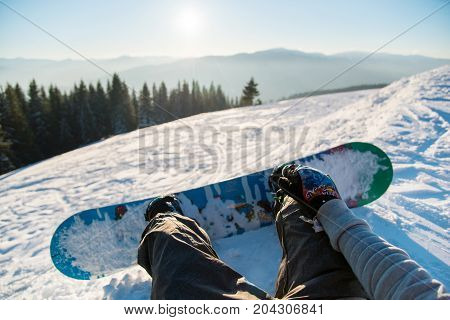 Point Of View Shot Of A Female Snowboarder Lying On The Snow On The Slope Relaxing After Riding, Enj