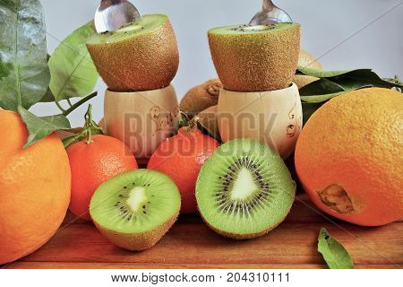 composition with fresh fruit ready to eat, kiwi and oranges