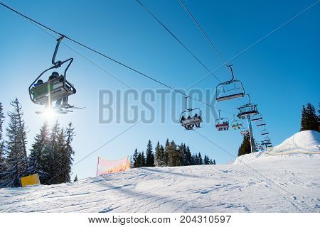 Low Angle Shot Of A Ski-lift In The Mountains On A Sunny Winter Day Copyspace People Riding Top Natu