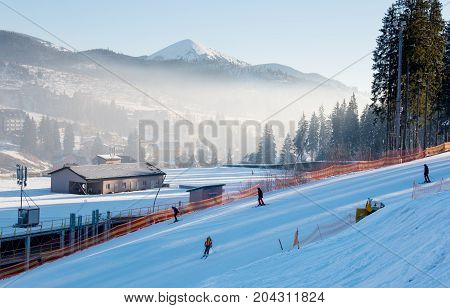 Shot Of A Skiers Skiing Down The Hill On A Beautiful Sunny Morning. The Snow-white Scenery Of Mounta