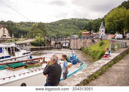 Lutzelbourg,France-September 06,2017, Boats  enter the locks at the river Zorn on the Canal de la Marne au Rhin
