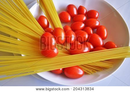 Italian cuisine, ingredients for tomato spaghetti, still life, part of a series