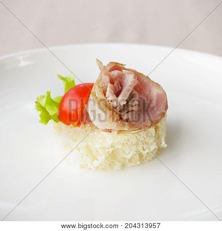 Canape With Ham, Lettuce And Vine Tomato