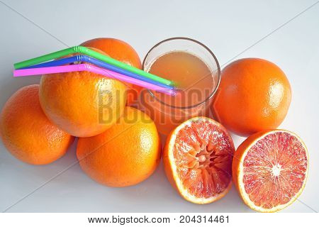 composition with oranges and orange juice, part of a series