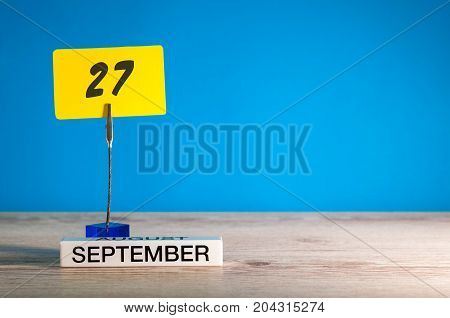 September 27th. Day 27 of month, Calendar on teacher or student, pupil table with empty space for text, copy space.