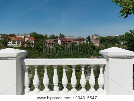 Beautiful views of the city. White marble railings. Blue sky. Sunny morning.