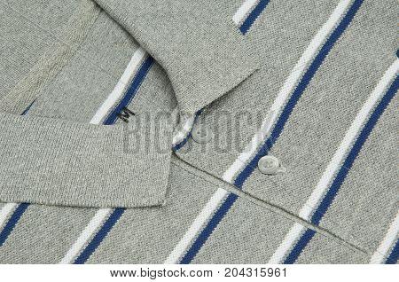 closeup t-shirt grey color and collar and buttons. shirt grey with buttons closeup