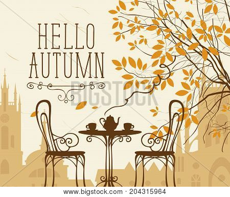 Vector landscape in retro style on the autumn theme with the words Hello autumn furnished outdoor cafe two cups and a kettle and autumn tree on a background of an old European city